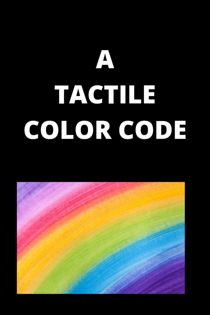 Photo description Text reads a tactile color code There is a graphic showing the colors of the rainbow below the text. Text is white and the background is black